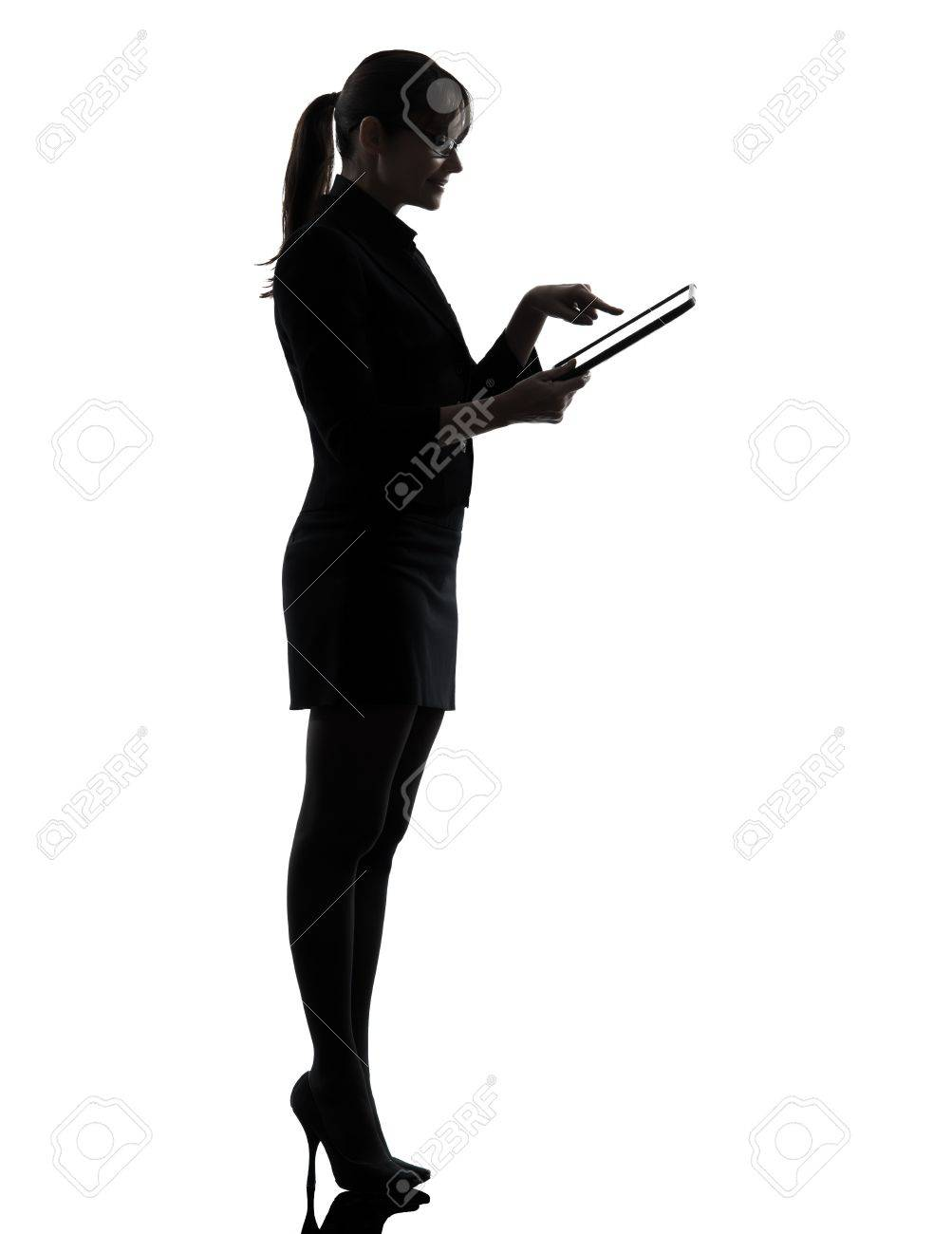 one caucasian business woman computer computing typing digital tablet in silhouette studio isolated on white background Stock Photo - 18632785