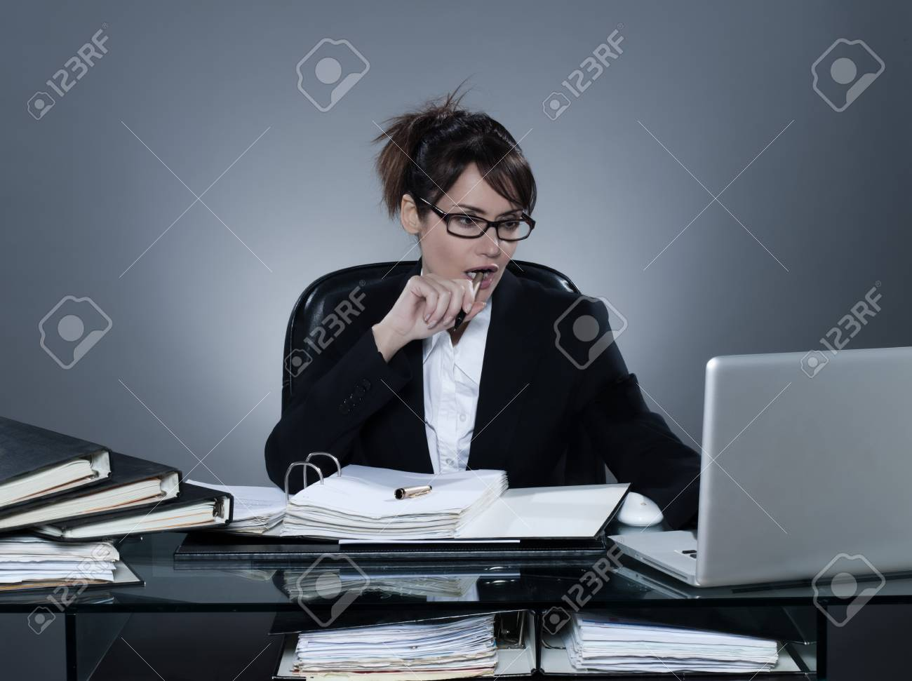 beautiful cheerful caucasian business woman working busy computing laptop computer sitting at desk on isolated background Stock Photo - 19084593