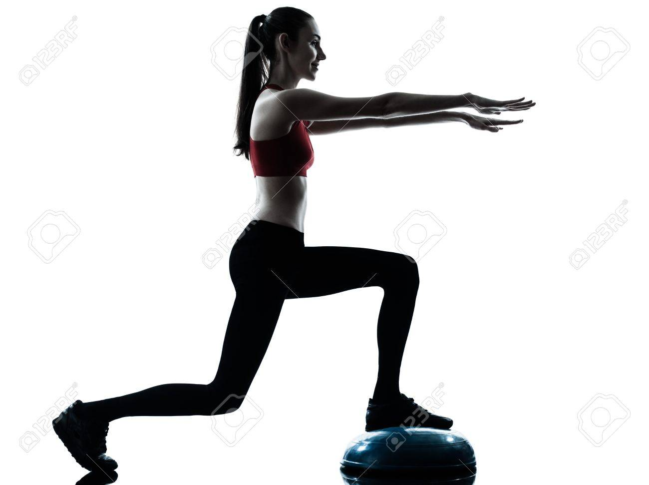 one caucasian woman exercising bosu balance ball trainer in silhouette studio isolated isolated on white background Stock Photo - 19234242