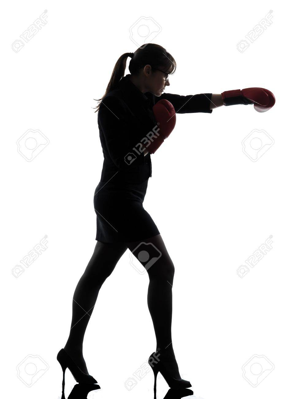 one business woman punch g with box g gloves silhouette studio