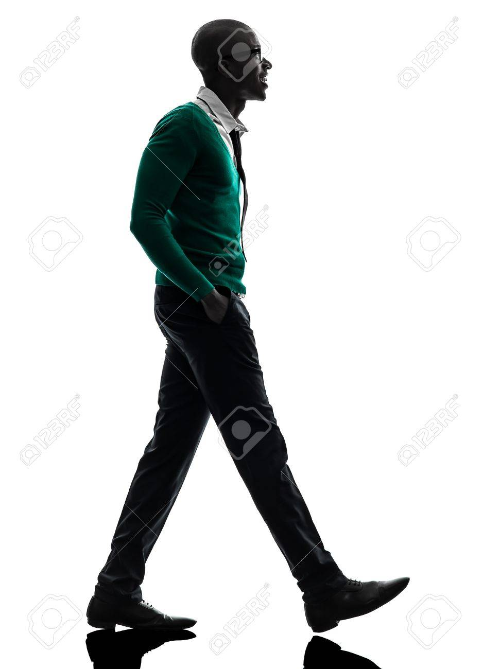 one african  black man walking in silhouette studio on white background Stock Photo - 20011501