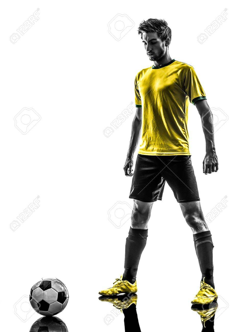 one brazilian soccer football player young man in silhouette studio  on white background Stock Photo - 20519447