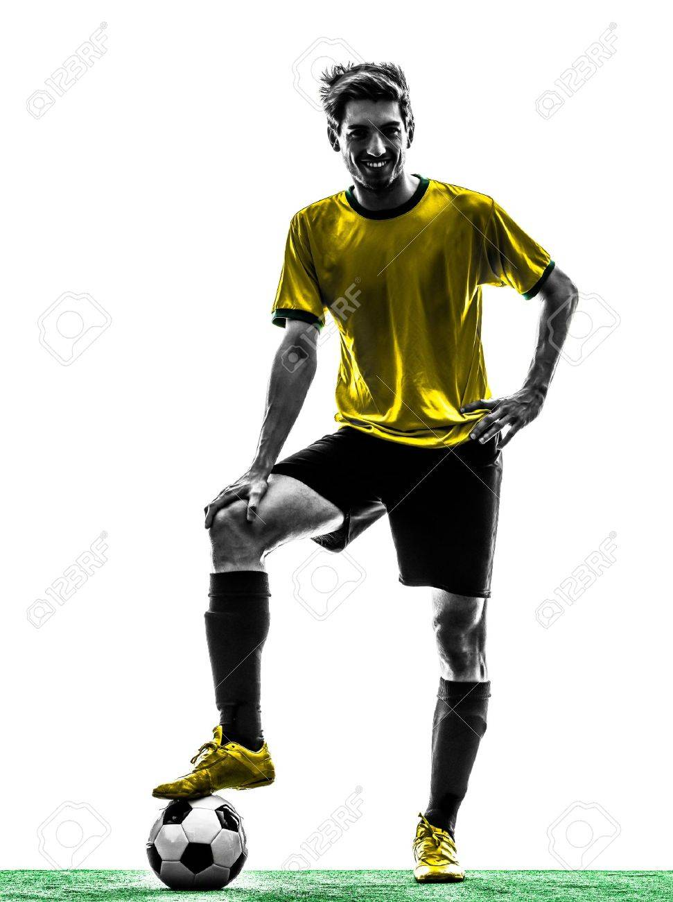one brazilian soccer football player young man standing in silhouette studio  on white background Stock Photo - 20893779