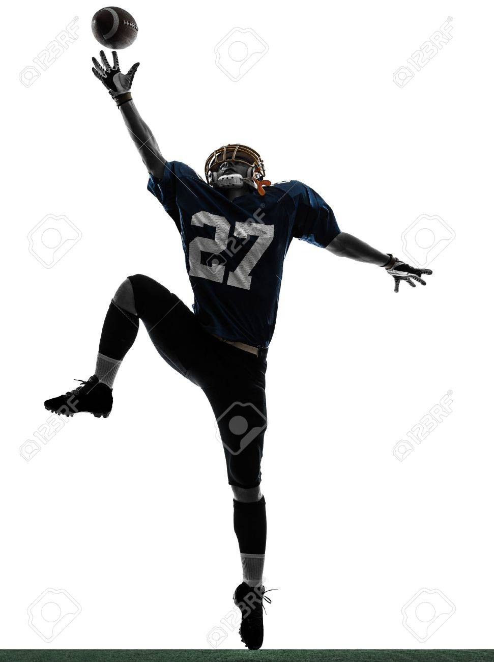 one caucasian american football player man catching receiving in silhouette studio isolated on white background Stock Photo - 21021684