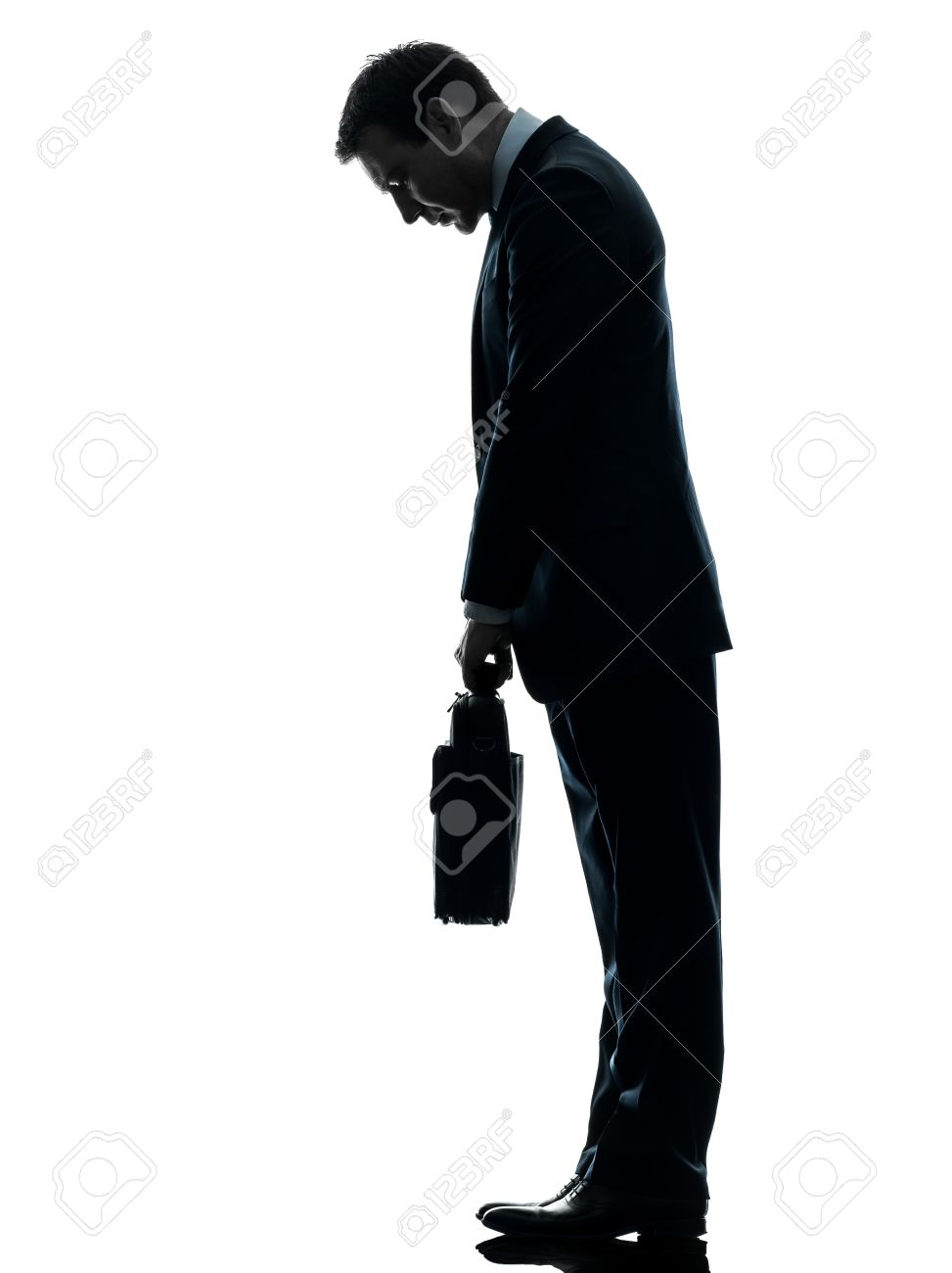 weakness images stock pictures royalty weakness photos and weakness one caucasian sad business man looking down in silhouette studio isolated on white background