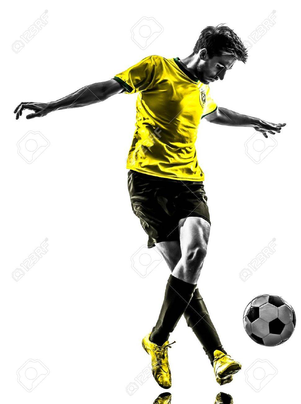 one brazilian soccer football player young man in silhouette studio  on white background Stock Photo - 21283663