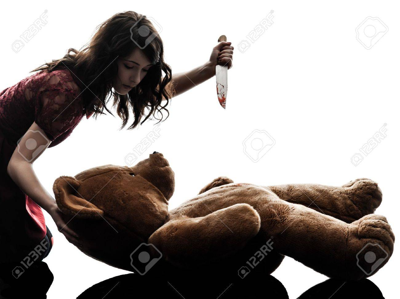 one caucasian strange young woman killing her teddy bear  in silhouette white background Stock Photo - 21708643