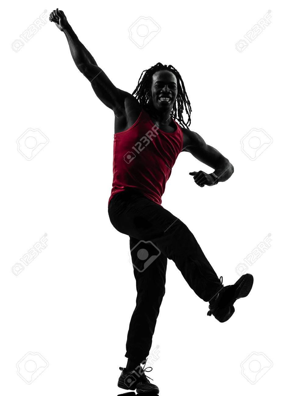 one african man exercising fitness zumba dancing  in silhouette  on white background Stock Photo - 23449244