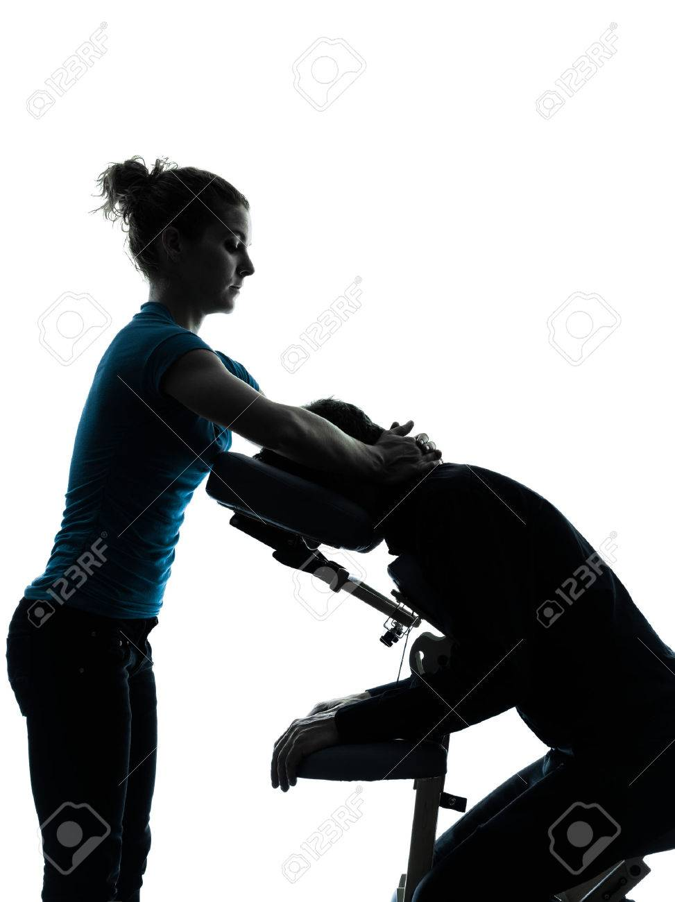 Chair massage therapy - One Man And Woman Performing Chair Massage In Silhouette Studio On White Background