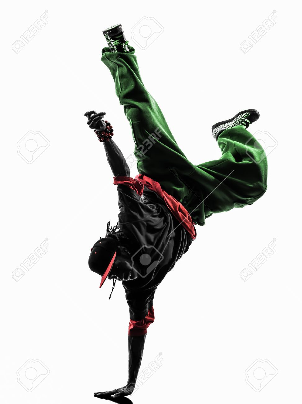 2597ba1d1 one hip hop acrobatic break dancer breakdancing young man handstand  silhouette white background Stock Photo -