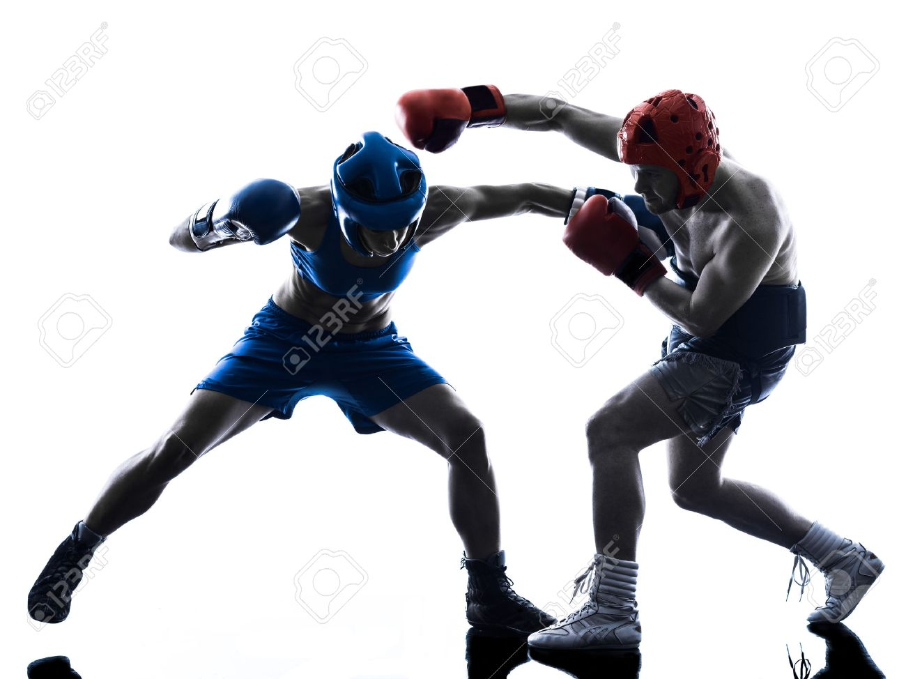 one woman boxer boxing one man kickboxing in silhouette isolated