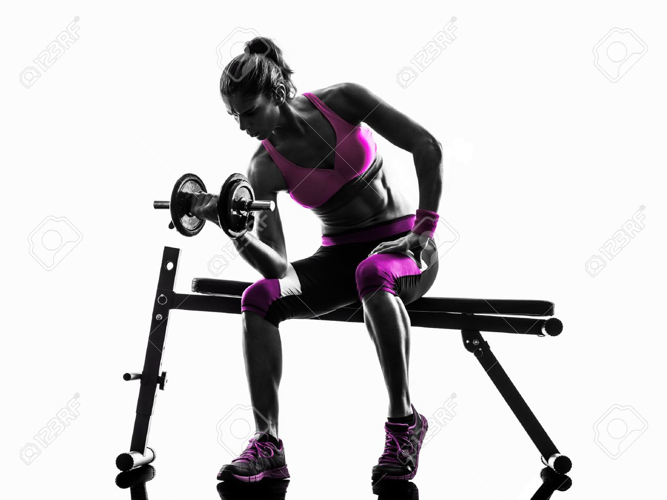 one caucasian woman exercising   weights body building fitness in studio silhouette isolated on white background Stock Photo - 45983280