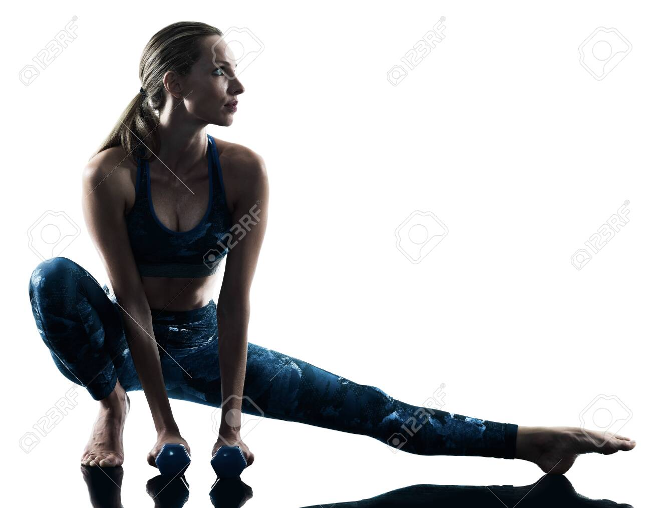 one caucasian woman exercising fitness weights excercises in silhouette isolated on white background - 121656670
