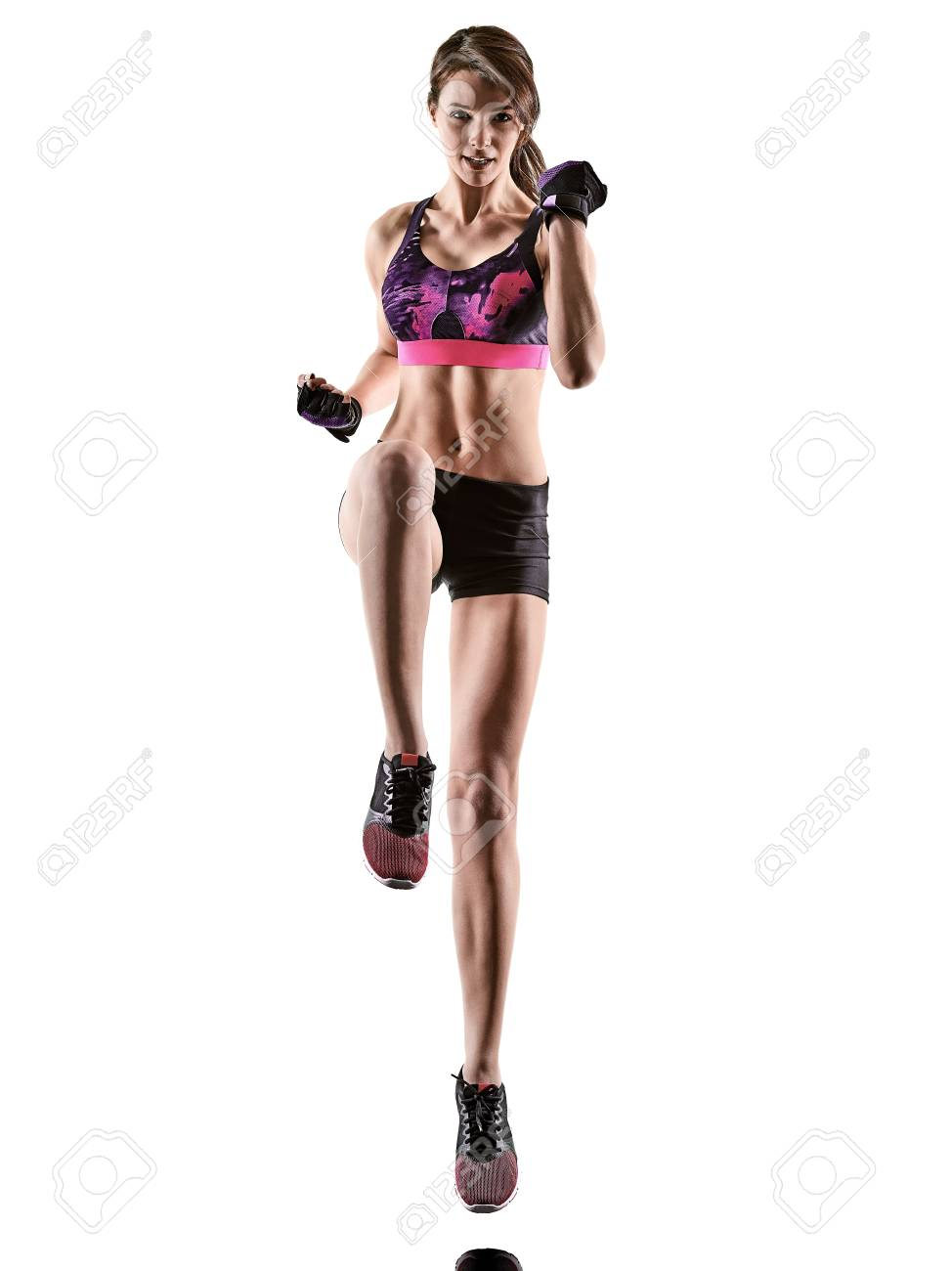 one caucasian woman exercising cardio boxing cross core workout fitness exercise aerobics silhouette isolated on white background - 123145593