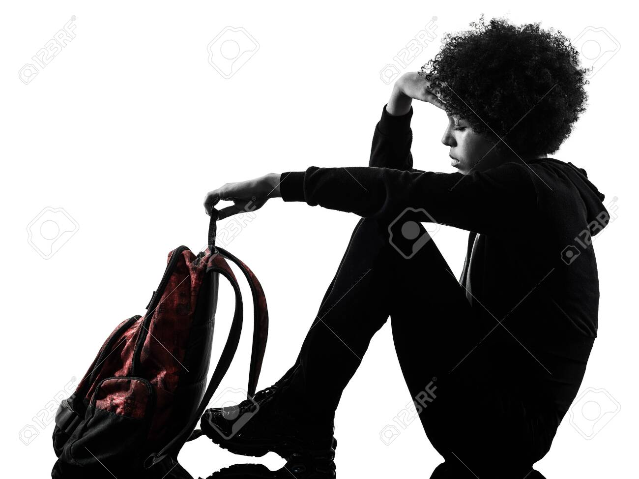 one mixed race african young teenager girl woman sadness depression in studio shadow silhouette isolated on white background - 124989801