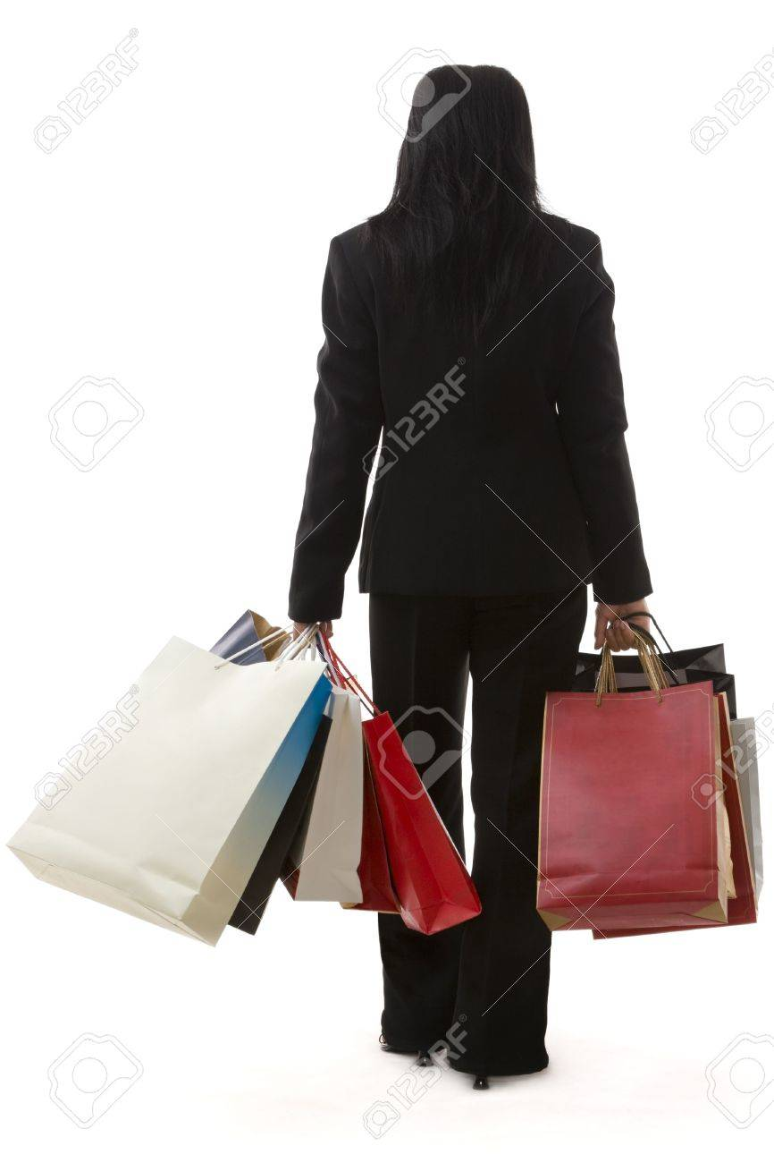 A Business Woman Is Carrying A Lot Of Shopping Bags, Shot From ...