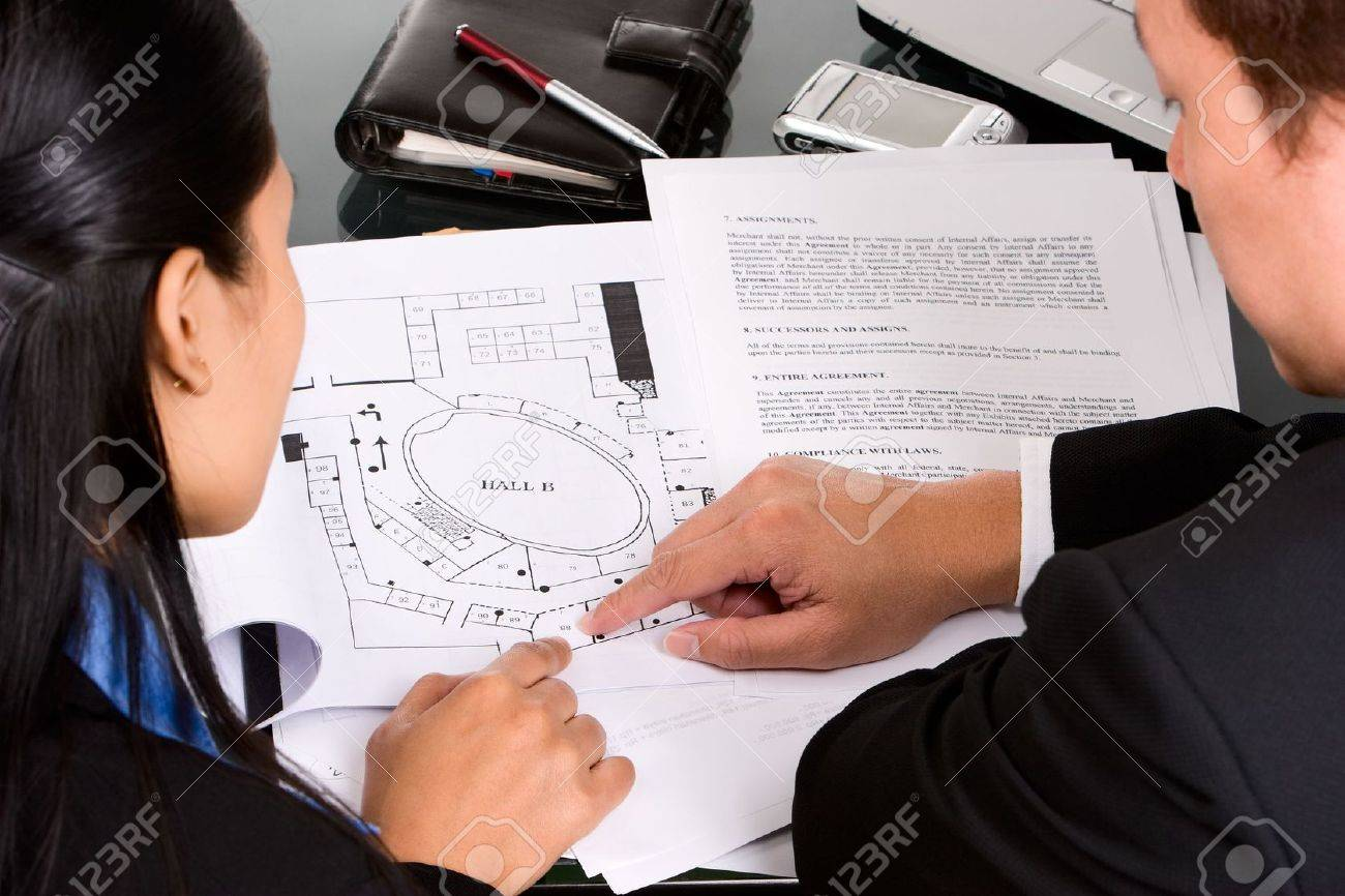 Two business people, man and woman discuss about their property planning. Stock Photo - 3802649