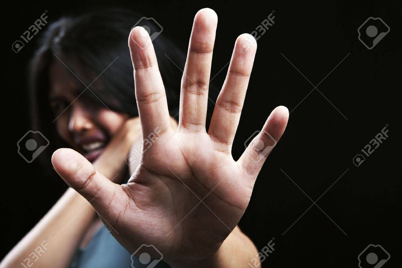 Young woman defending herself, can be used for domestic violence concept Stock Photo - 5836864
