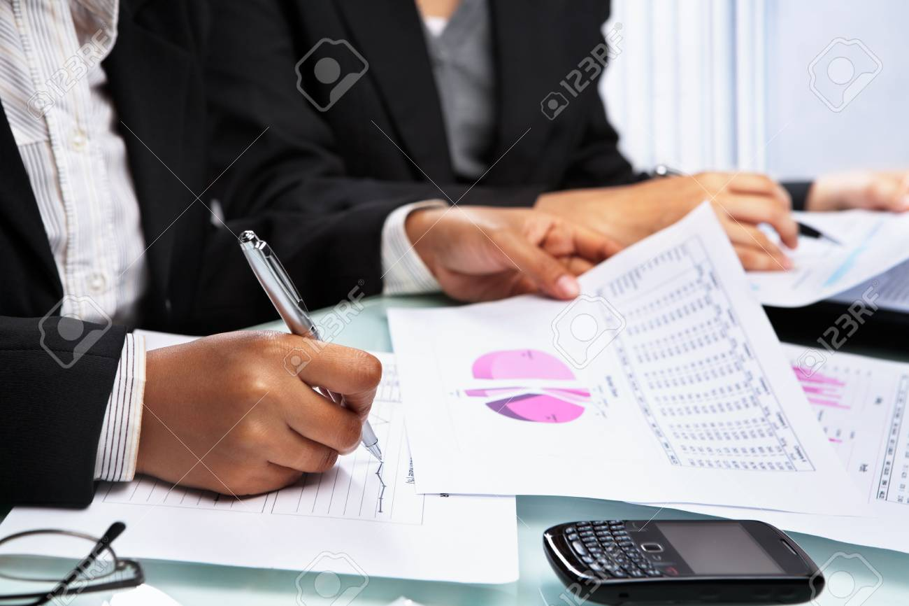 Asian Businesswomen working and analyzing data and statistic Stock Photo - 6525873
