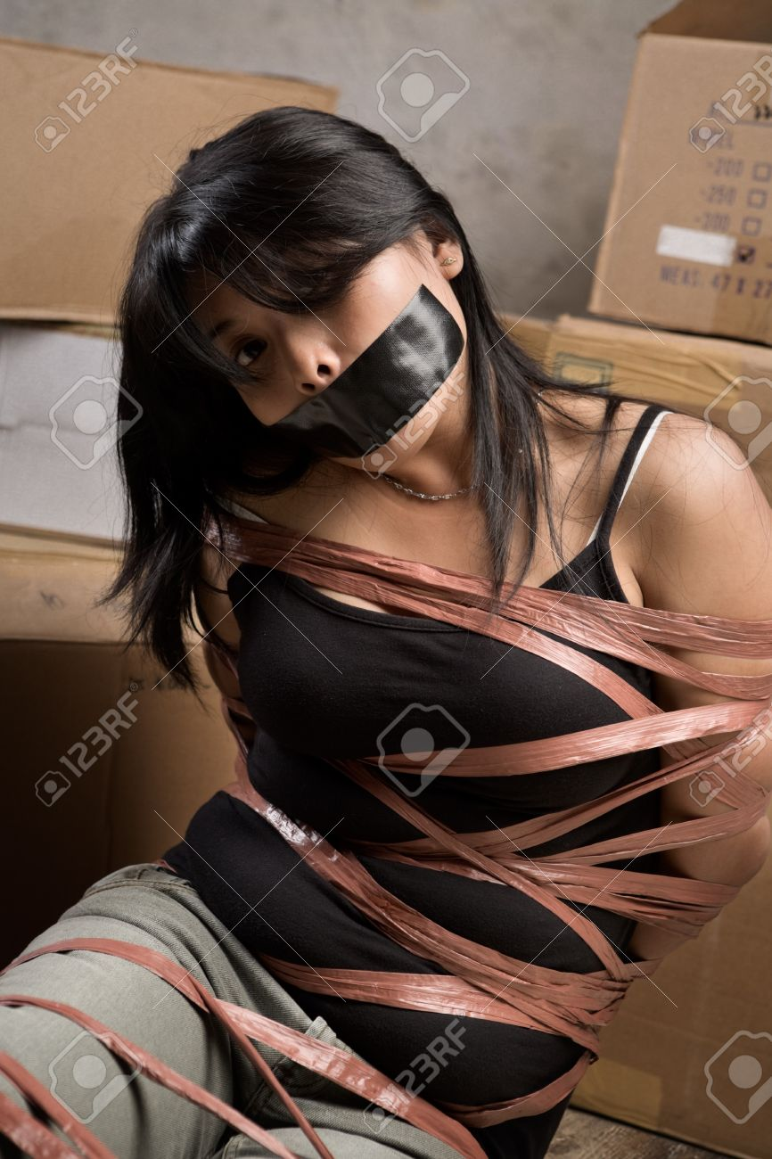 littlegirl tied up silenced: A young woman tied-up muted in old room. Low key setting