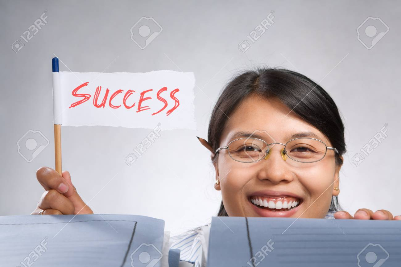Happy woman holding success flag made of paper and pencil Stock Photo - 7283157