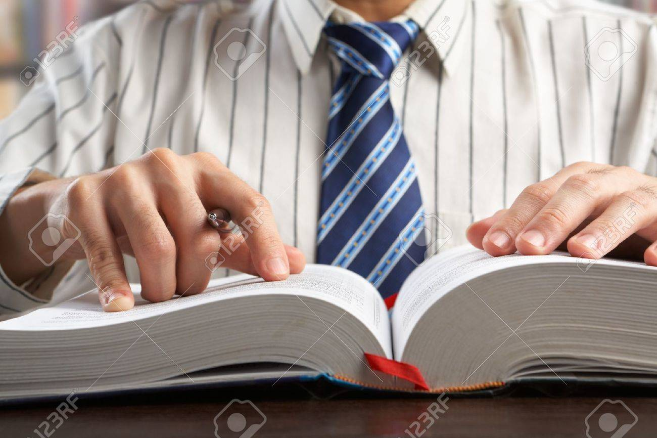 Unrecognizable businessman or professor reading journal to search for data in library Stock Photo - 7284089