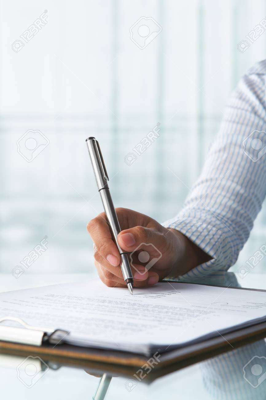 Businesswoman signing agreement paper in the office Stock Photo - 7283809