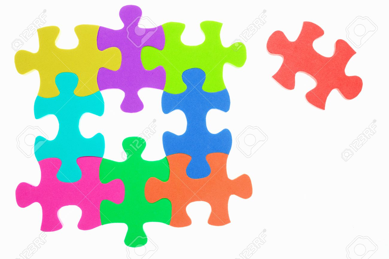 Colorful jigzaw puzzle with the last one unattached, isolated over white background Stock Photo - 8875926