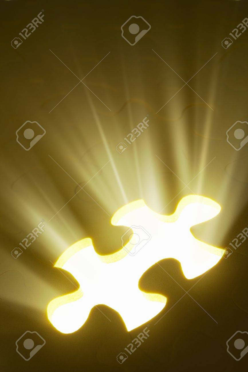 Concept photo using piece of puzzle with ray of light comes out from missing piece Stock Photo - 8875688