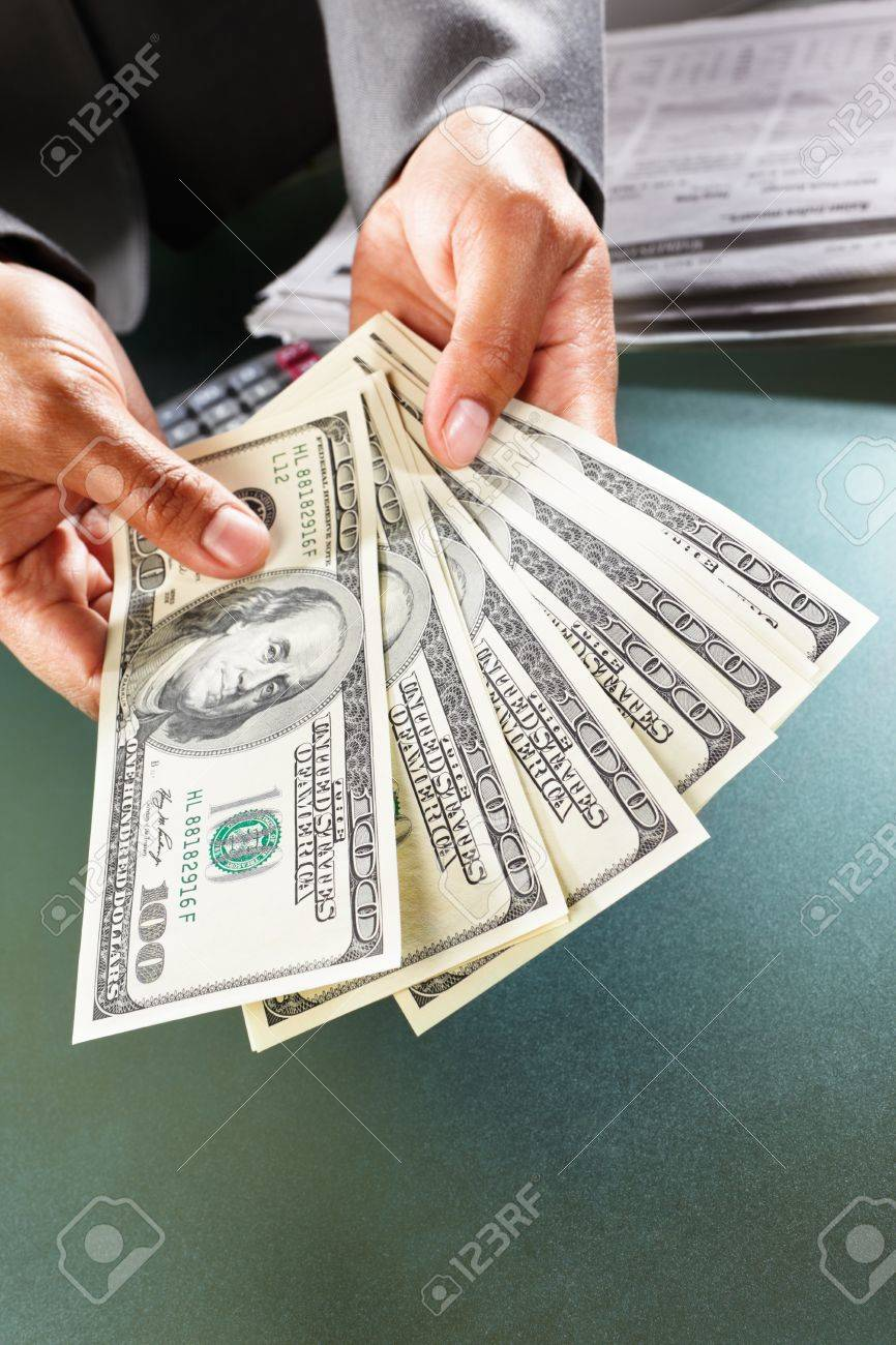 Busineswoman hand counting US dollar bills, taken close up Stock Photo - 9113136