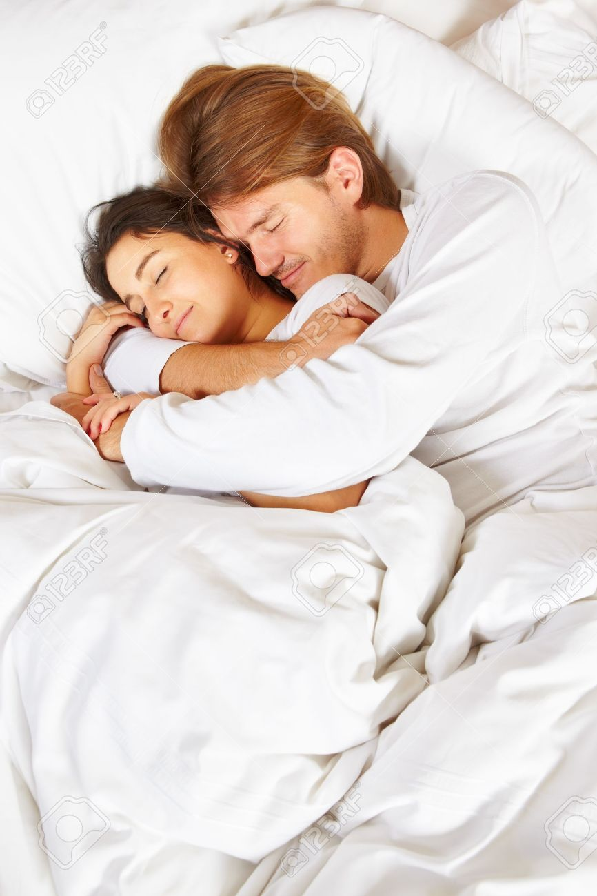 Happy couple showing their romance on fully covered white bed Stock Photo - 9553687