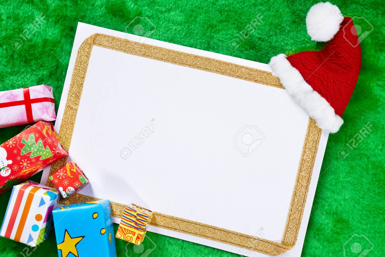 Blank White Paper Surrounded By Christmas Presents Stock Photo ...