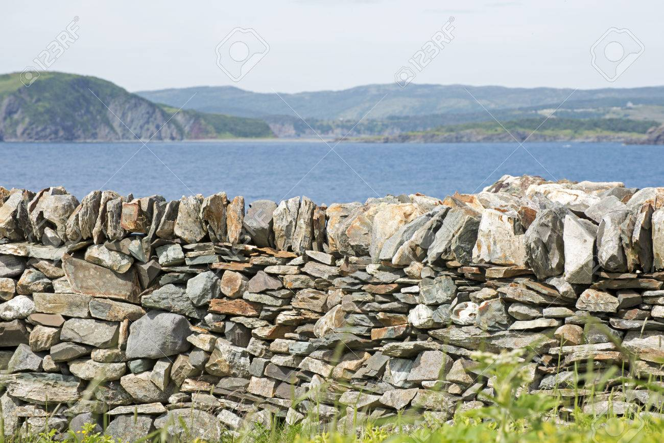 stone retaining wall with atlantic ocean in background newfoundland