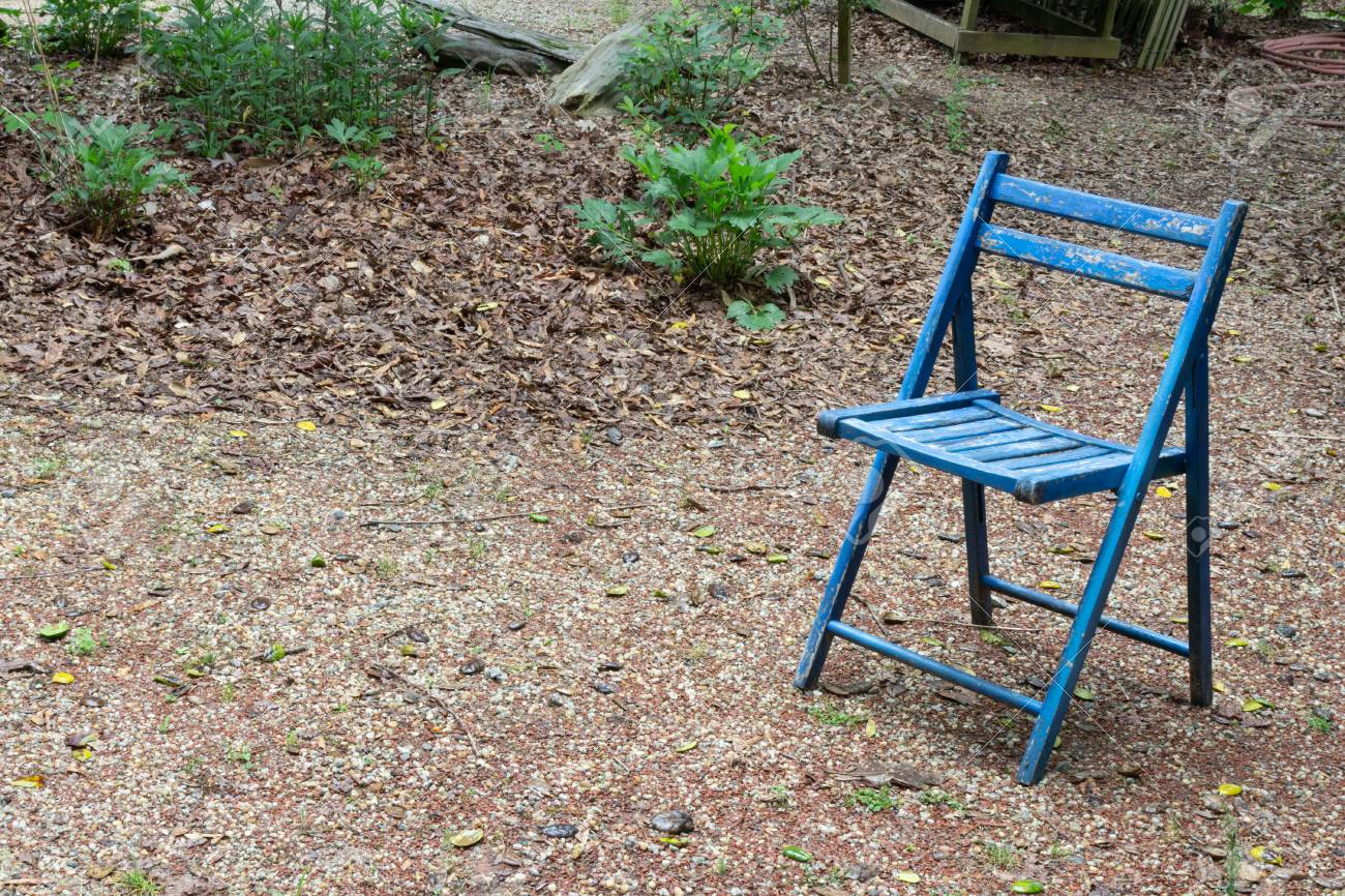 Awe Inspiring Empty Blue Folding Chair Outdoors Copy Space Death Grief Absense Ncnpc Chair Design For Home Ncnpcorg
