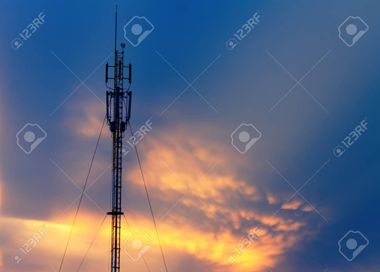 antenna has a sky background with sun rays are shining up into the sky Stock Photo - 14574644