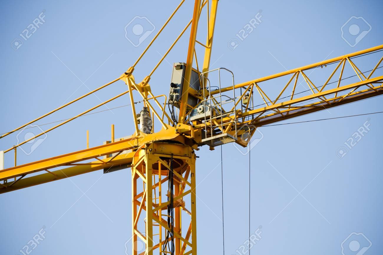 Yellow Crane against Blue Sky Stock Photo - 12164583
