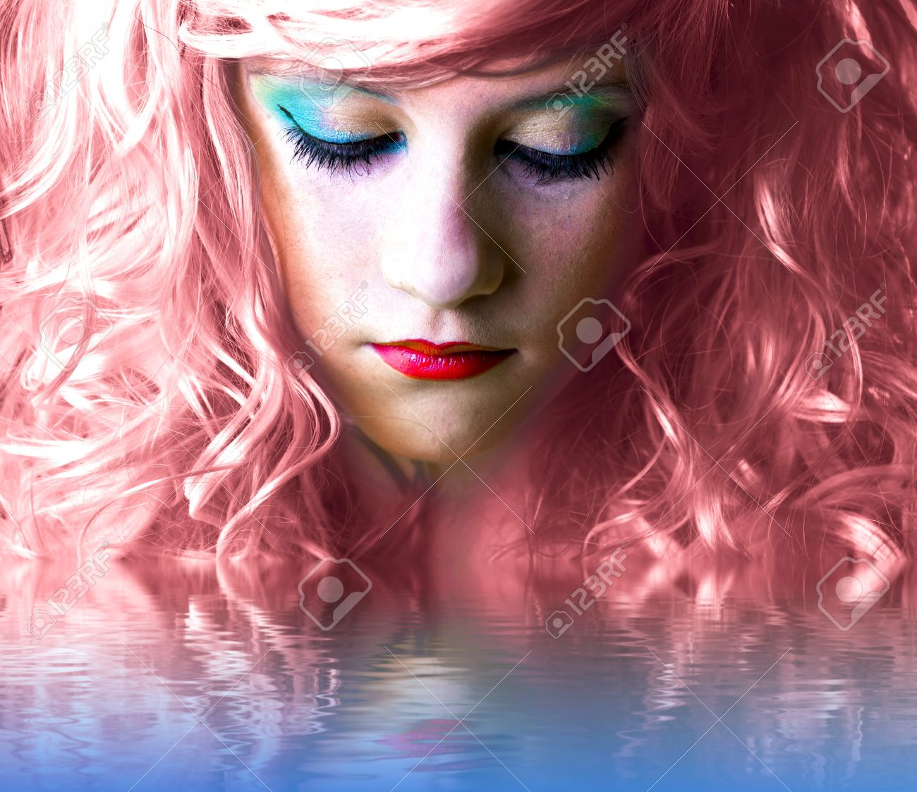 pink haired fairy girl in water reflection Stock Photo - 13344525