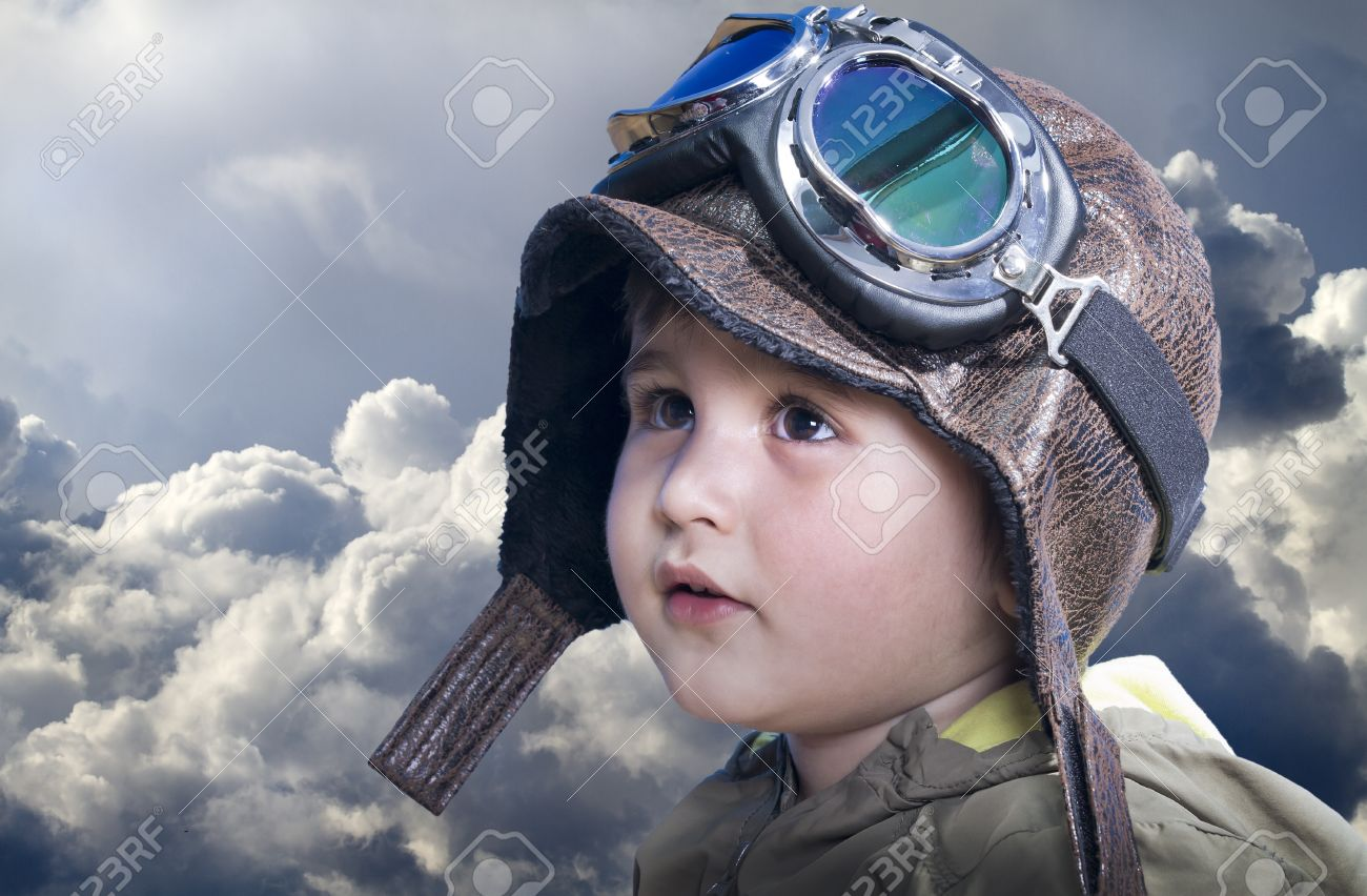 A little cute baby dreams of becoming a pilot. Pilot outfit, hat and glasses Stock Photo - 13454248