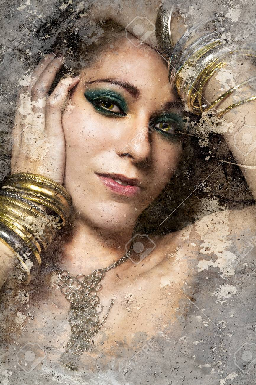 Artistic portrait with textured background, beautiful woman with gold and silver jewelry Stock Photo - 16959192