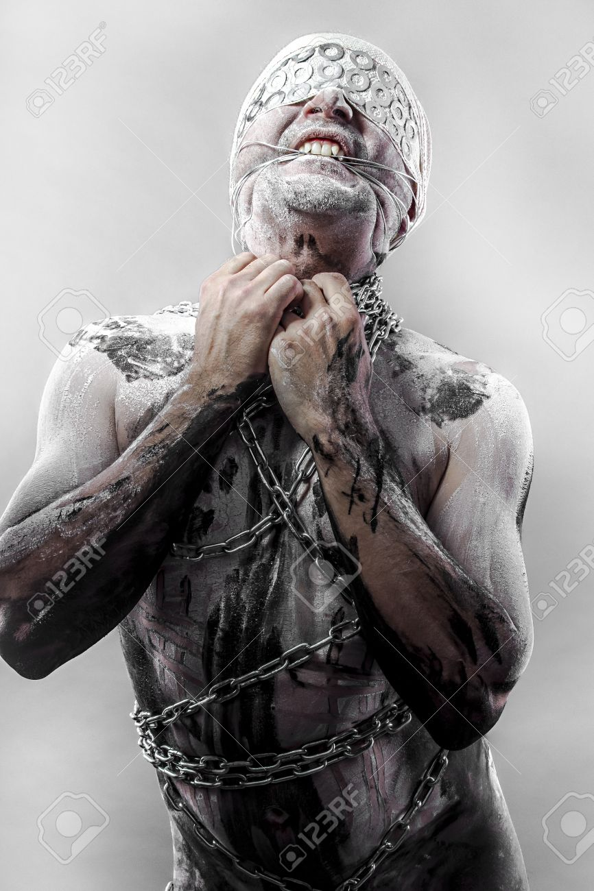 Pain, Bondage, man covered in bandages and wounds, chained Stock Photo - 22113685