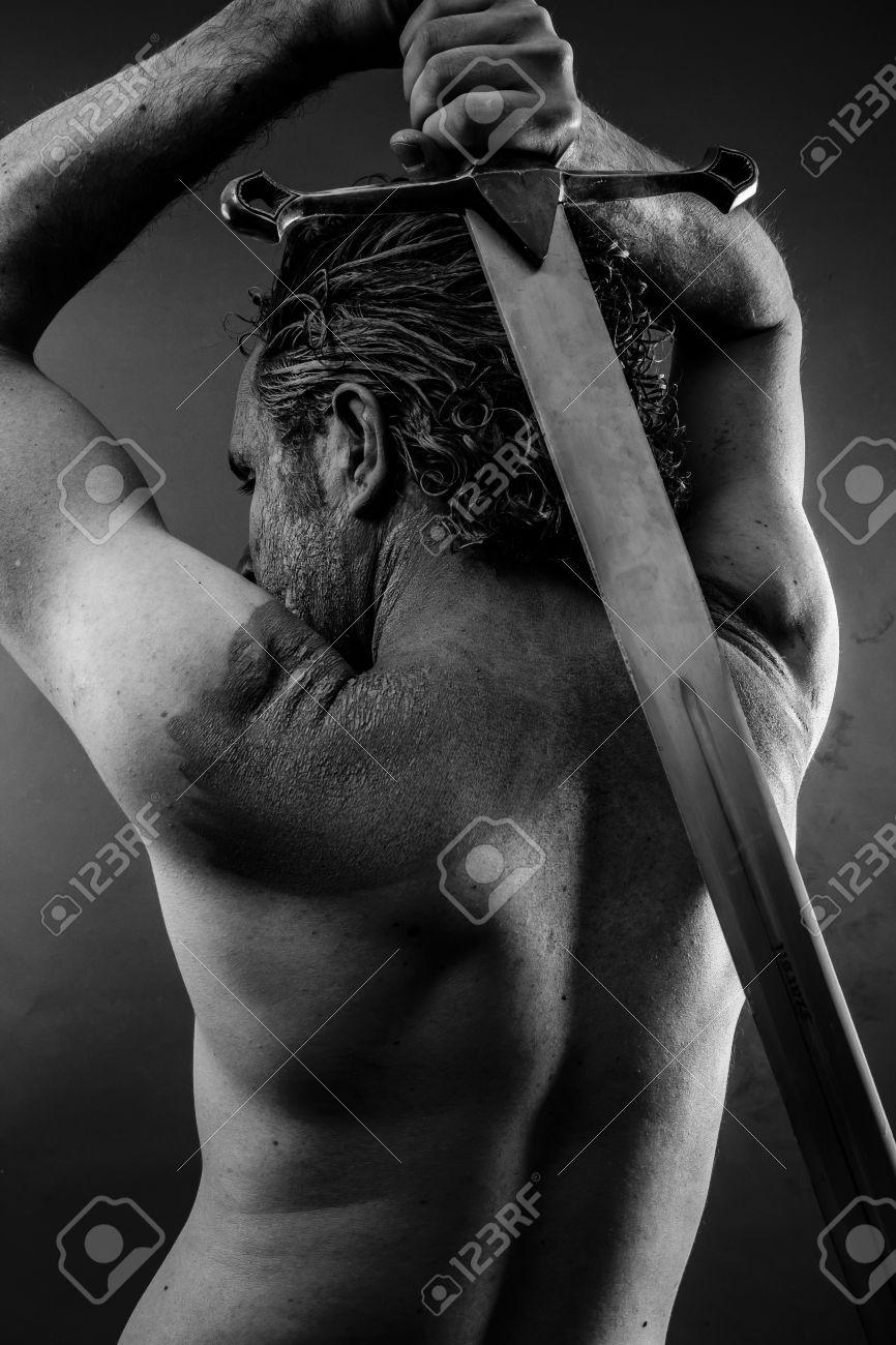 Wild Warrior with huge metal sword Stock Photo - 24725002