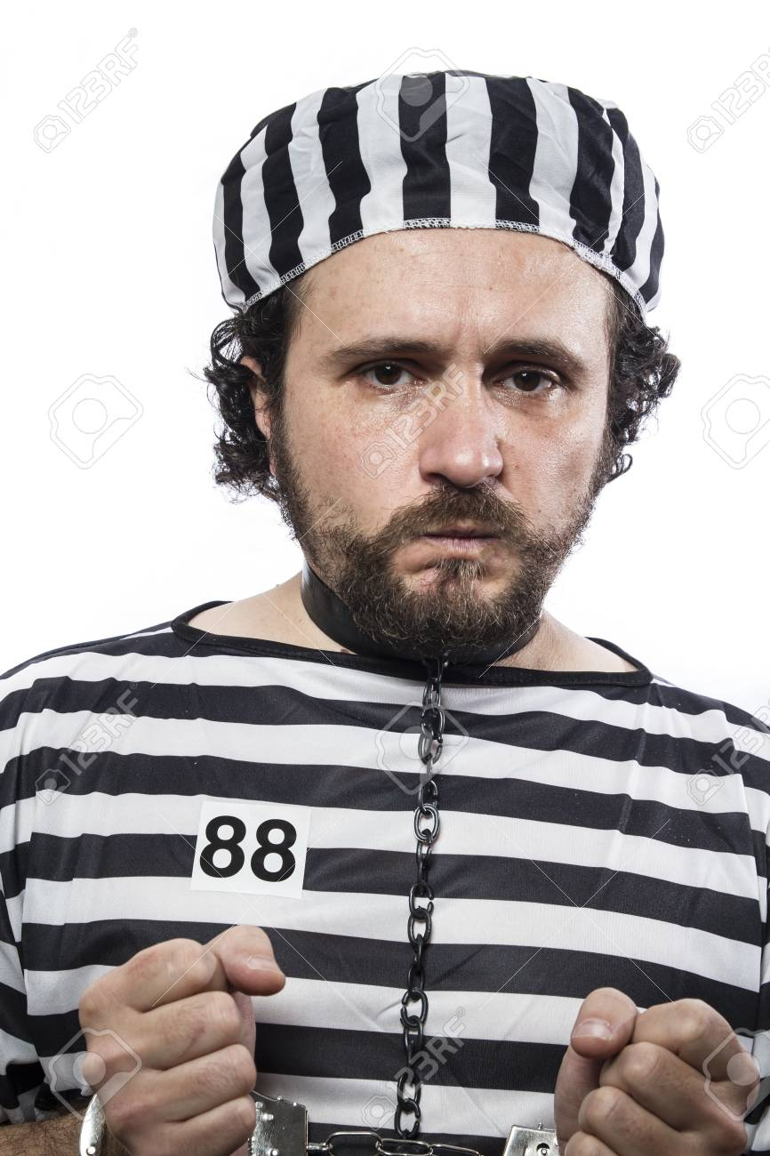 Violence, one caucasian man prisoner criminal with chain ball and handcuffs in studio isolated on white background Stock Photo - 26290225