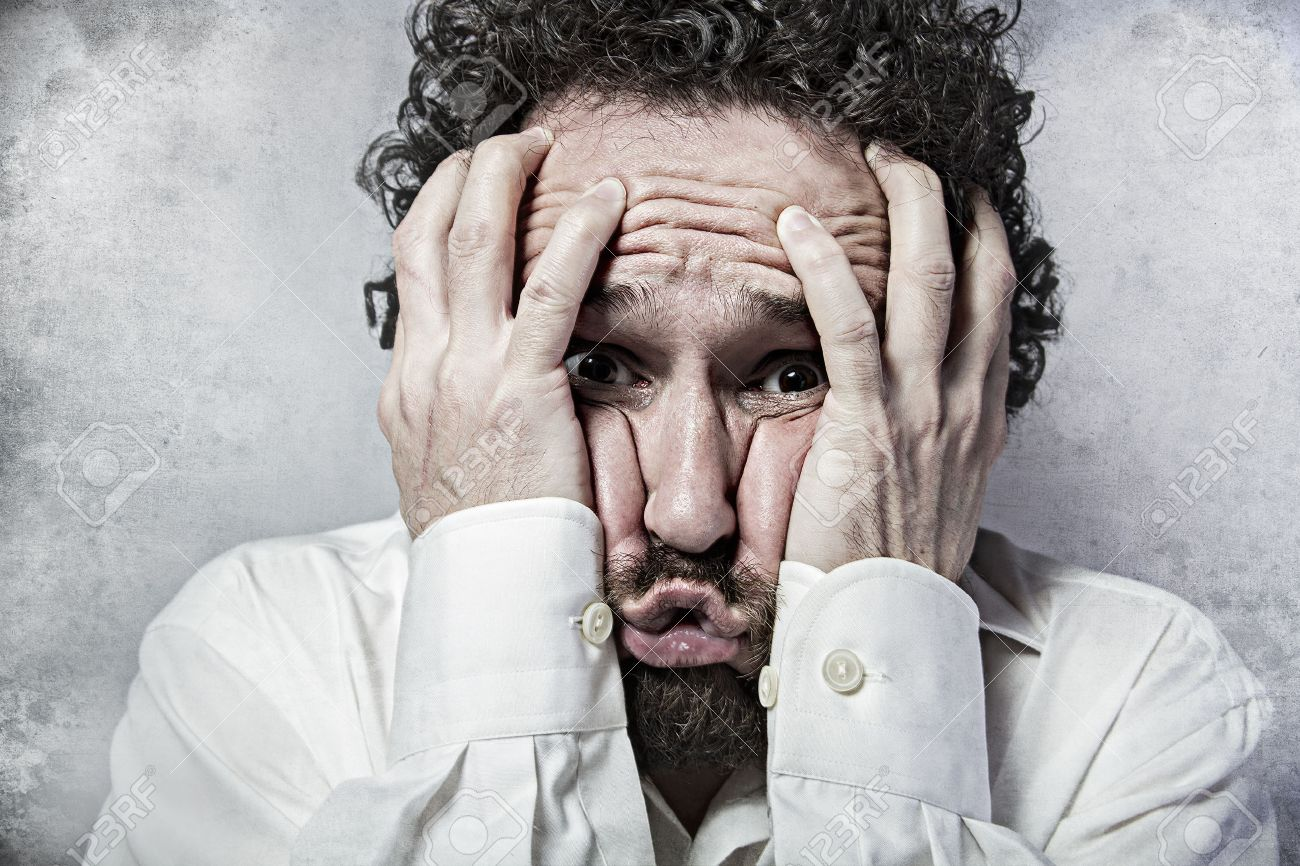 Fear, man in white shirt with funny expressions Stock Photo - 26291678