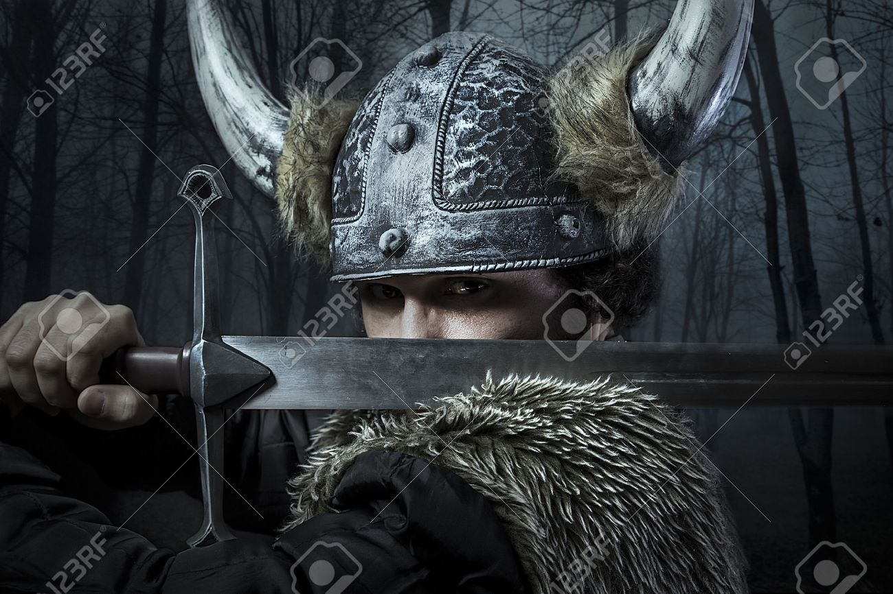 Defense, Viking warrior, male dressed in Barbarian style with sword, bearded - 26334346