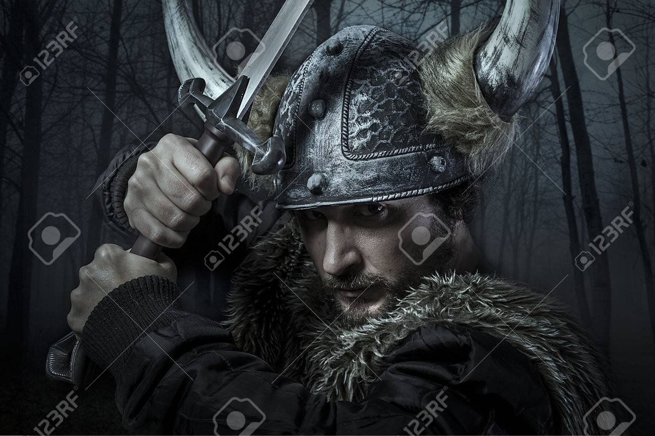 Viking warrior, male dressed in Barbarian style with sword, bearded Stock Photo - 26335262