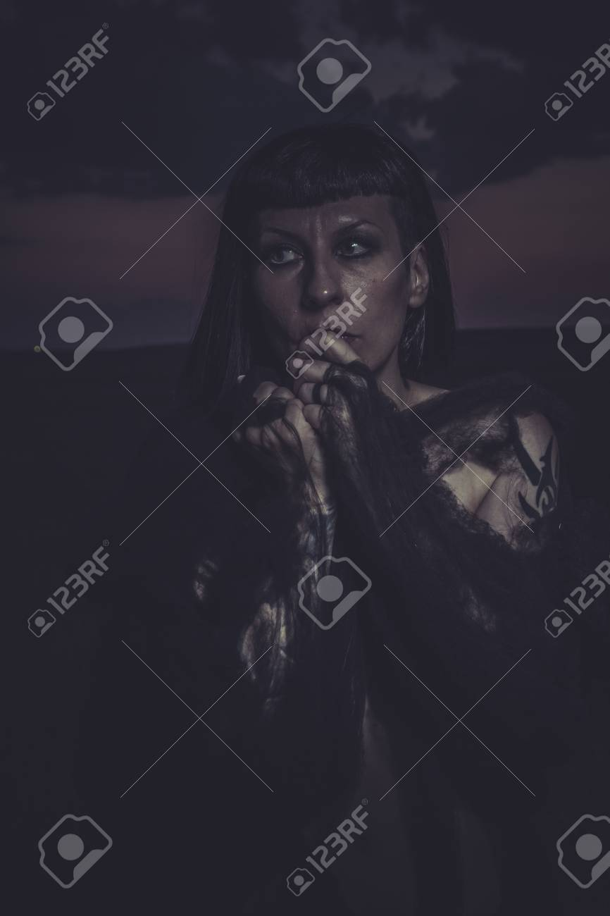 fear Gothic beauty at sunset, naked brunette woman Stock Photo - 28950570