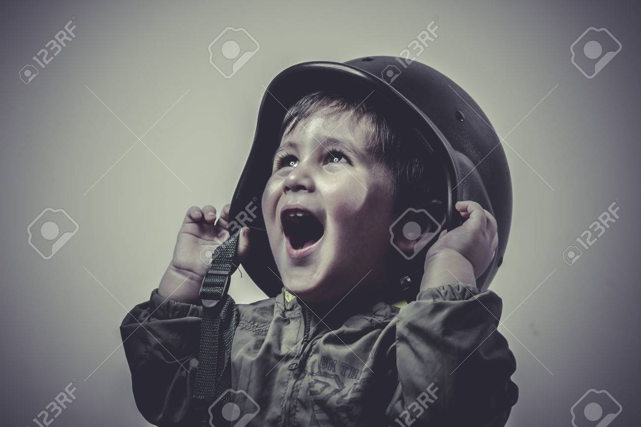 uniform, fun and funny child dressed in military cap, playing war games Stock Photo - 28948895