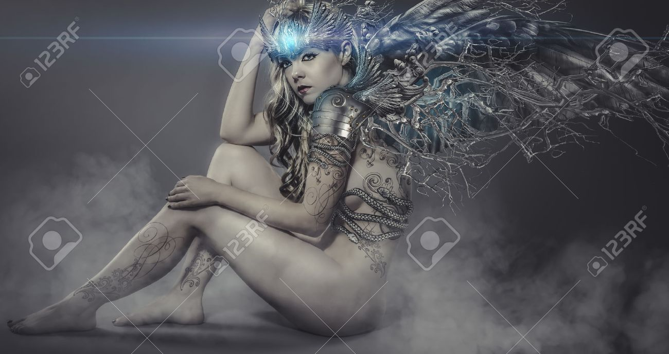 nude woman with iron and metal wings, art scene with gothic effects Stock Photo - 30448332