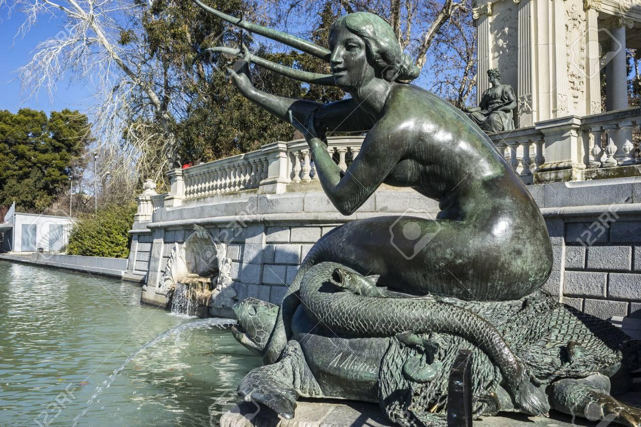 bronze sculpture of a mermaid lake in retiro park madrid spain