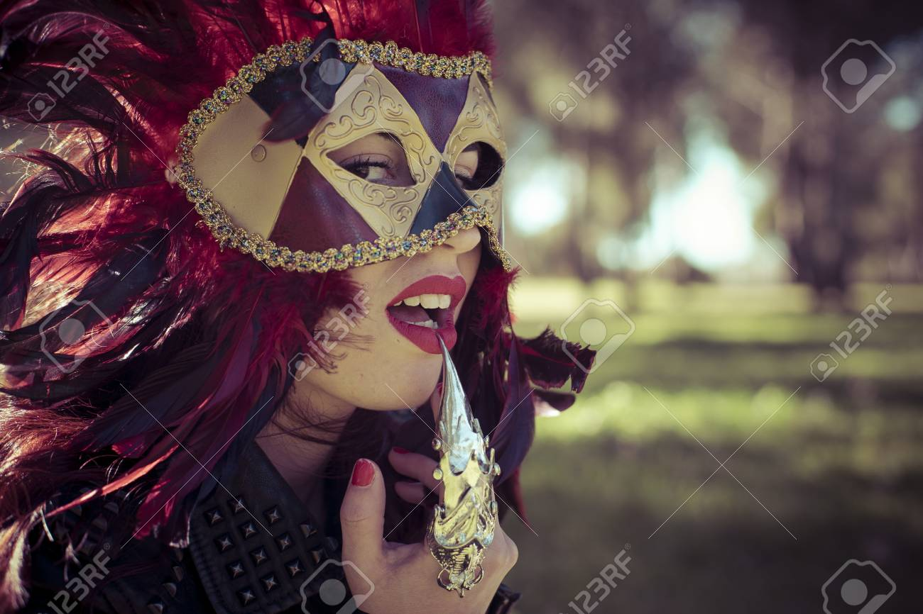 b17c9710e20ab Carnival, beautiful woman with full lips and Venetian mask at sunset Stock  Photo - 42329789
